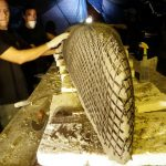 Florida University students making a basalt reinforced concrete canoe.