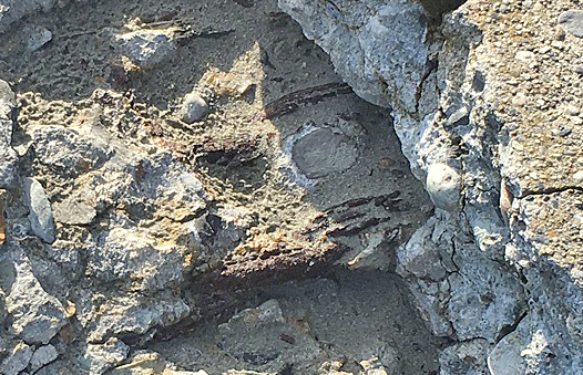 Newport RI, beach concrete wall with spalling